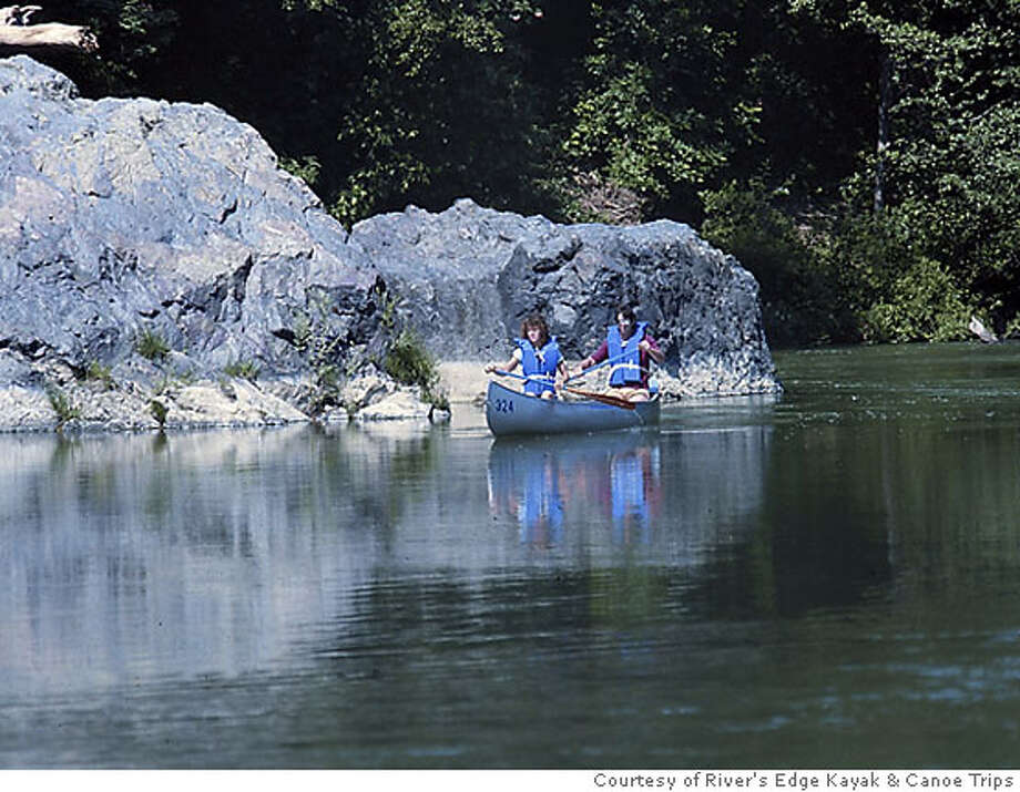 TRAVEL DESTINATIONS -- River's Edge Kayak and Canoe Trips in Healdsburg rents watercraft and designs trips along the Russian River. photo courtesy River's Edge Kayak and Canoe Trips  Ran on: 05-20-2007  River's Edge Kayak & Canoe Trips operates on a less-traveled section of the Russian River. Photo: HO