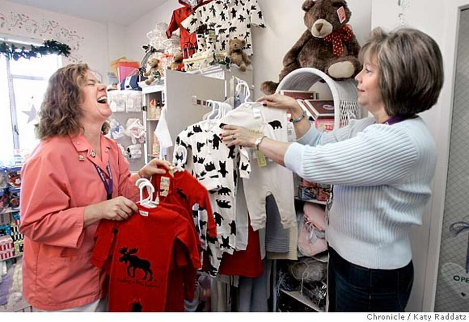 Story about volunteers. SHOWN: Jill Silvestri (LEFT, wearing pink), a volunteer at Marin General Hospital, shares a laugh with the manager of the Baby Nook, Patti (cq) Cassidy (R). The Baby Nook is a store in the hospital for new parents. Photo taken on 11/17/05, in Corte Madera, CA.  By Katy Raddatz / The San Francisco Chronicle Photo: Katy Raddatz