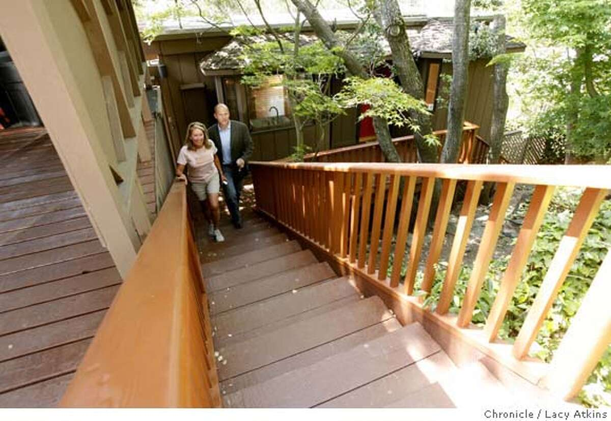 Realtor Payton Stiewe shows a median marked home in Mill Valley to developer Cheryl Cason, May 16, 2007, in Mill Valley, CA. Numbers show that Marin Counties median home price is $1,010.00 the first time any California county has surpassed the $1 million mark.(Lacy Atkins /San Francisco Chronicle) MANDATORY CREDITFOR PHOTGRAPHER AND SAN FRANCISCO CHRONICLE/NO SALES-MAGS OUT