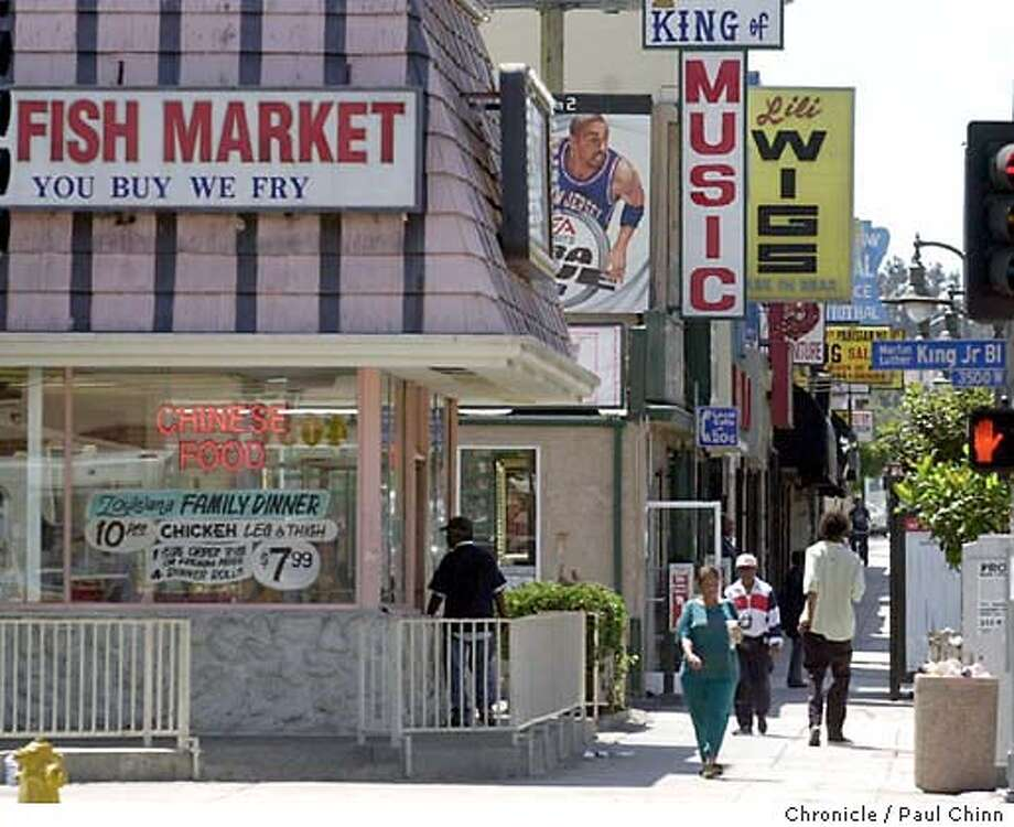 MLK Blvd. and Crenshaw Blvd. intersect in the heart of the neighborhood. The Crenshaw district in Los Angeles on 8/22/03. PAUL CHINN / The Chronicle Photo: PAUL CHINN