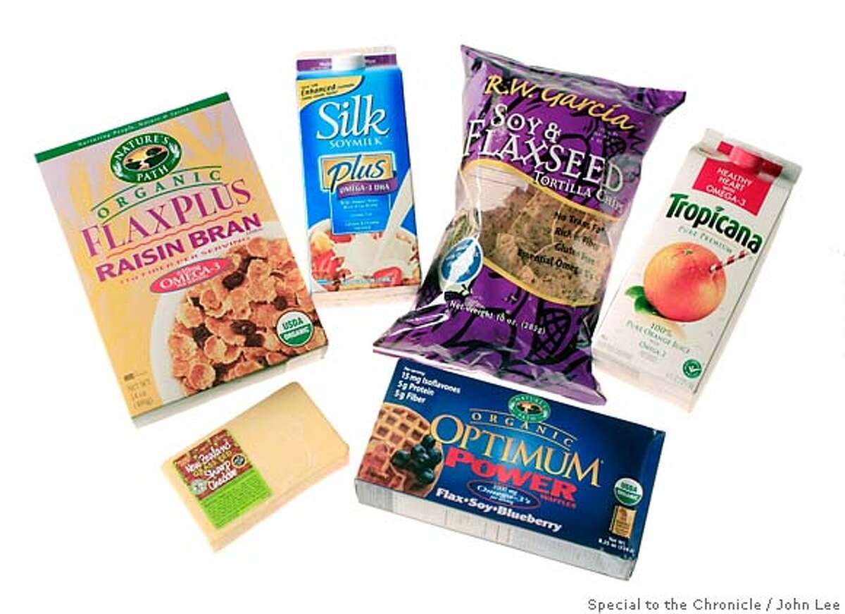 OMEGA16_JOHNLEE.JPG New foods containing Omega 3 fatty acids. Horizon Organic Milk, Nature's Path cereal, RW Garcia Chips, Tropicana Orange Juice, Frozen Waffles, cheddar cheese. By JOHN LEE/SPECIAL TO THE CHRONICLE