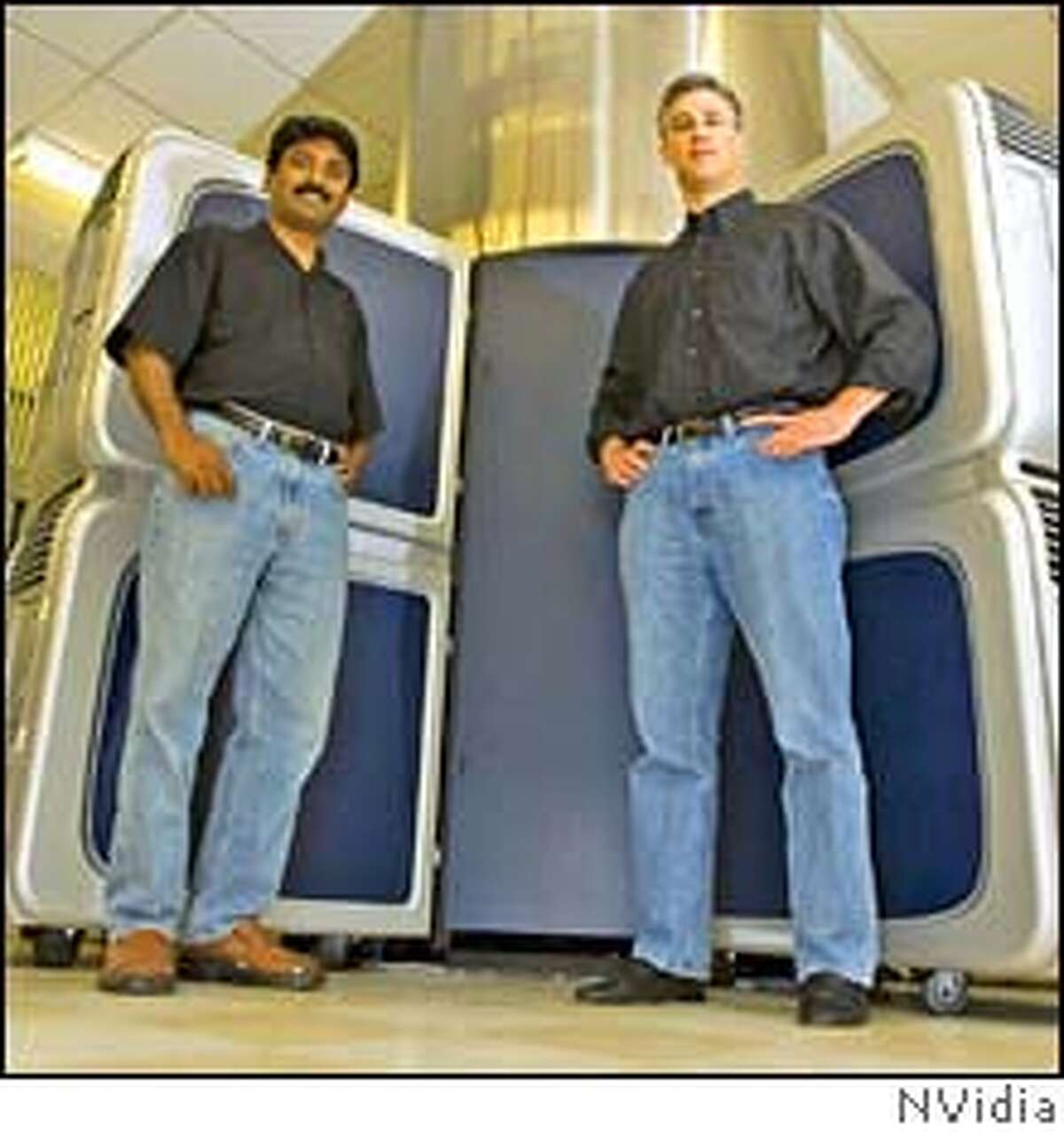 Narendra Konda (left) and Brian Kellerher test chip designs at Nvidia using the customized computer array from Cadence Design Systems. source: Nvidia