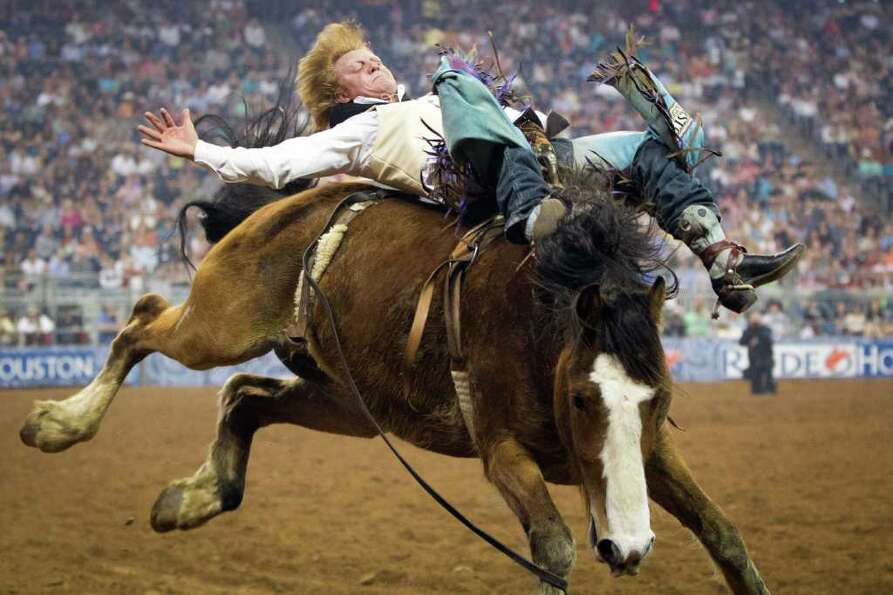 J.R. Vezain hangs on to Spanish Bit in the bareback riding competition during Cinch Super Shootout o