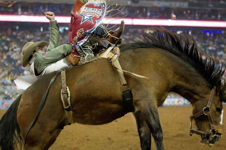 Everything is bigger in Texas, including the rodeos. The Houston Livestock show and Rodeo drew 2,257,970 in 2011. Photo: Smiley N. Pool, Houston Chronicle / © 2012  Houston Chronicle