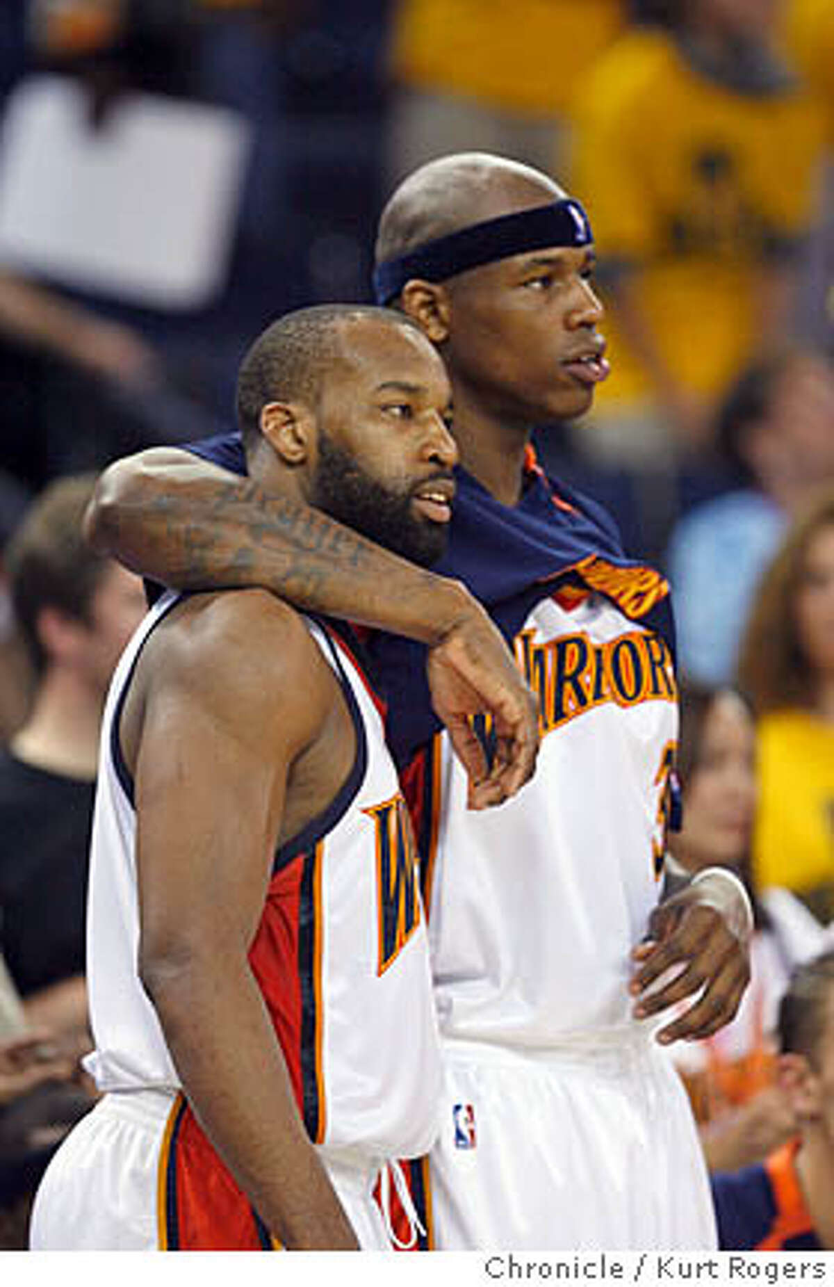 Baron Davis and Monta Ellis watch the last few seconds wind down in the 4th qiarter. The Golden State Warriors Vs Utah Jazz in game 4. SUNDAY, MAY 13, 2007 KURT ROGERS OAKLAND SFC KURT ROGERS/THE CHRONICLE WARRIORS_4rdqtr_game4_4476_kr.jpg Ran on: 05-14-2007 Baron Davis (left) and Al Harrington can only console each other during the latter stages of the Game 4 loss. Ran on: 05-14-2007 Baron Davis (left) and Al Harrington can only console each other during the latter stages of the Game 4 loss.