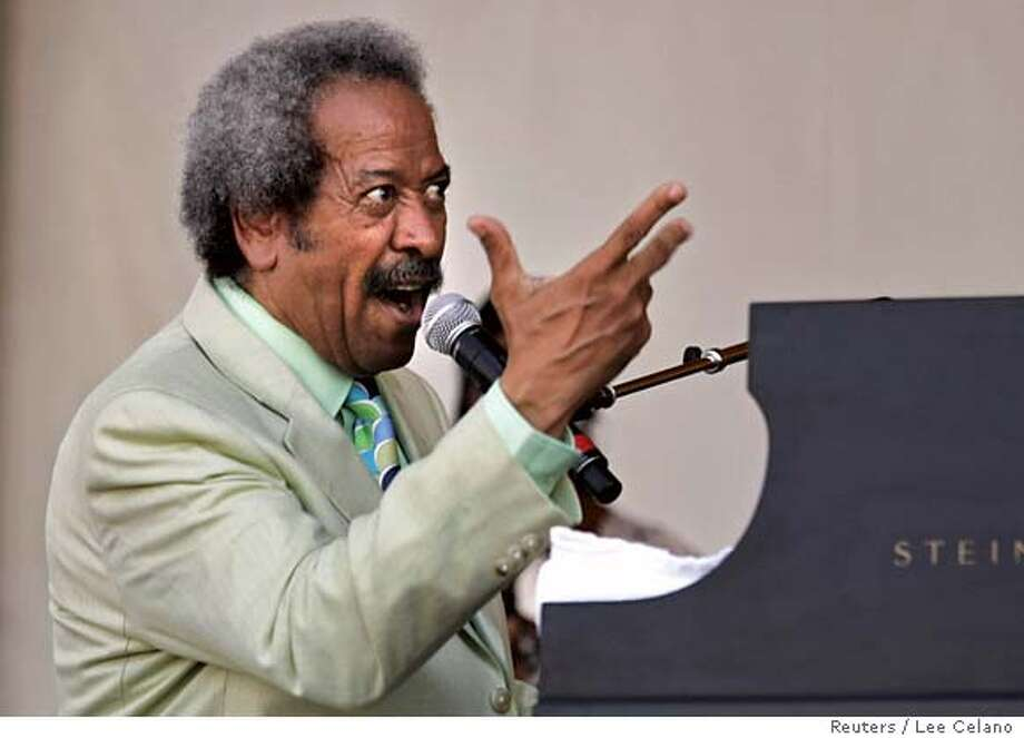 Musician and songwriter Allen Toussaint performs at the New Orleans Jazz and Heritage Festival in New Orleans, Louisiana May 6, 2007. REUTERS/Lee Celano (UNITED STATES) 0 Photo: LEE CELANO