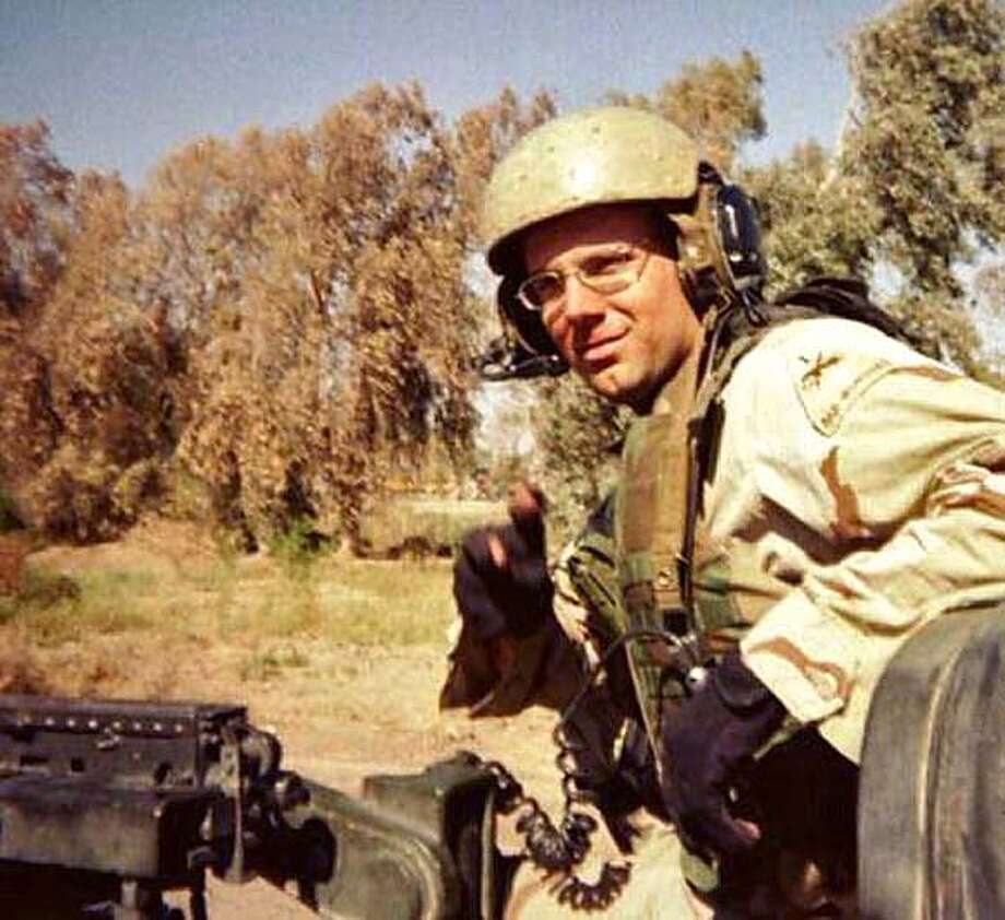 Lt. Ken Ballard, 26 of Mountain View, in a recent photo from Iraq. Ballard was a tank platoon leader and had been in Baghdad a little over a year. His family was notified Monday, May 31, 2004 - Memorial Day, that he was killed in action in Iraq. His mother, Karen Meredith last talked to Ken last Thursday, May 27. (SPECIAL TO THE MERCURY NEWS) FOR DATABASE Photo: HANDOUT
