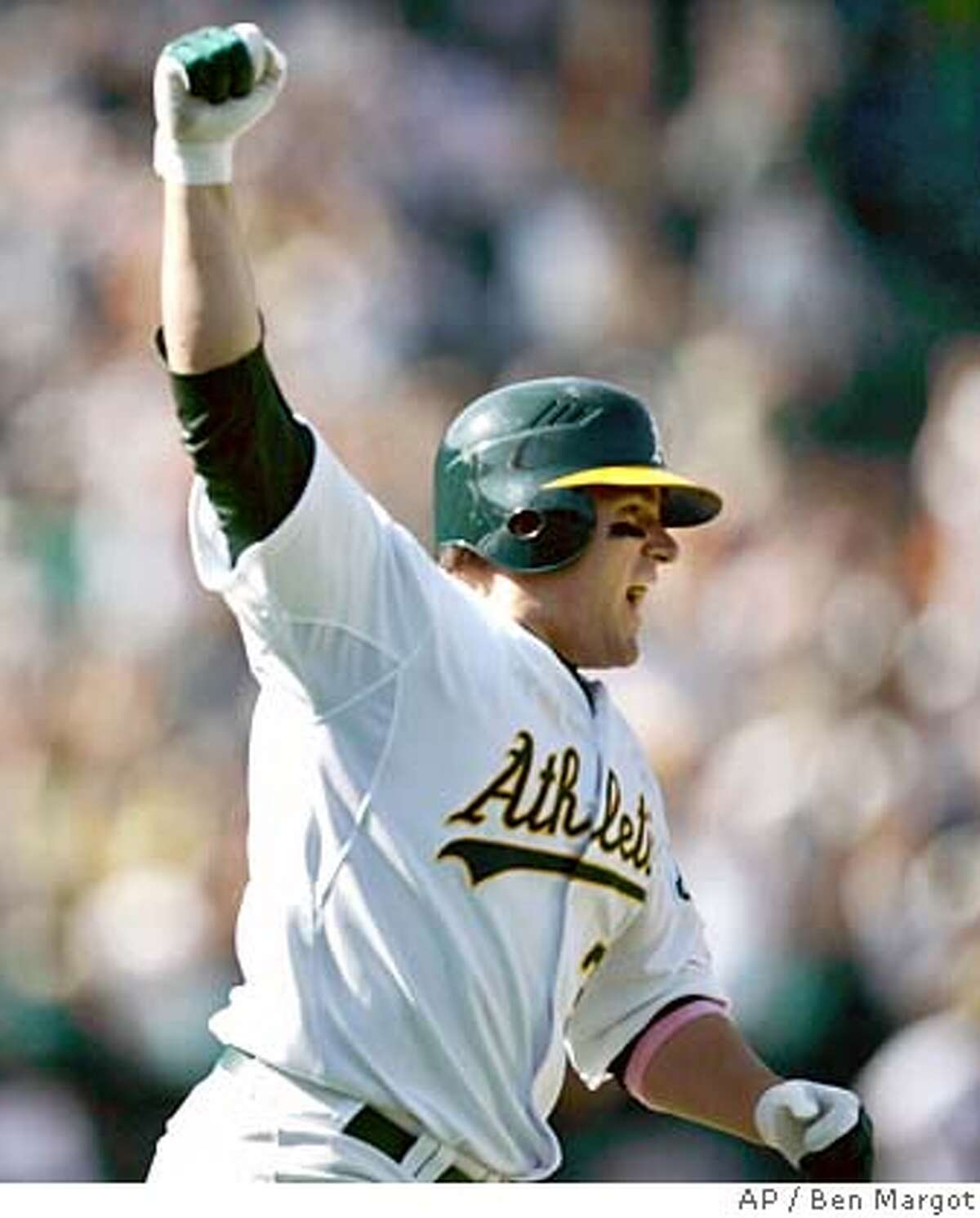 Oakland Athletics' Jack Cust celebrates after hitting a three-run walk-off home run off Cleveland Indians' Fernando Cabrera to win the baseball game 10-7 Sunday, May 13, 2007, in Oakland, Calif. (AP Photo/Ben Margot)