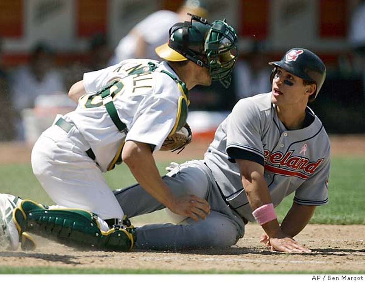 Cleveland Indians' Grady Sizemore, right, beats the tag from Oakland Athletics' Jason Kendall to score in the sixth inning of a baseball game Sunday, May 13, 2007, in Oakland, Calif. Sizemore scored on a double by Casey Blake. (AP Photo/Ben Margot)