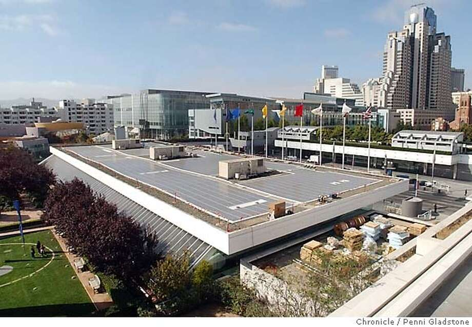 The push for green energy, such as solar panels on the Moscone Center, is causing an economic shift. Chronicle photo, 2003, by Penni Gladstone