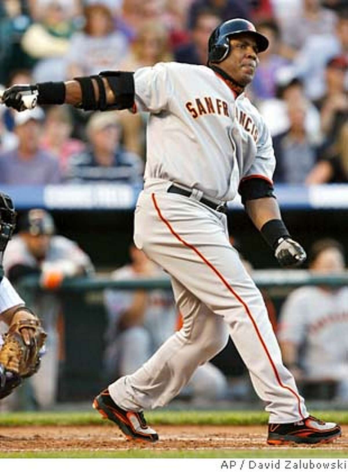 San Francisco Giants' Barry Bonds lines-out to Colorado Rockies first baseman Todd Helton in the second inning in Denver on Friday, May 11, 2007. (AP Photo/David Zalubowski)