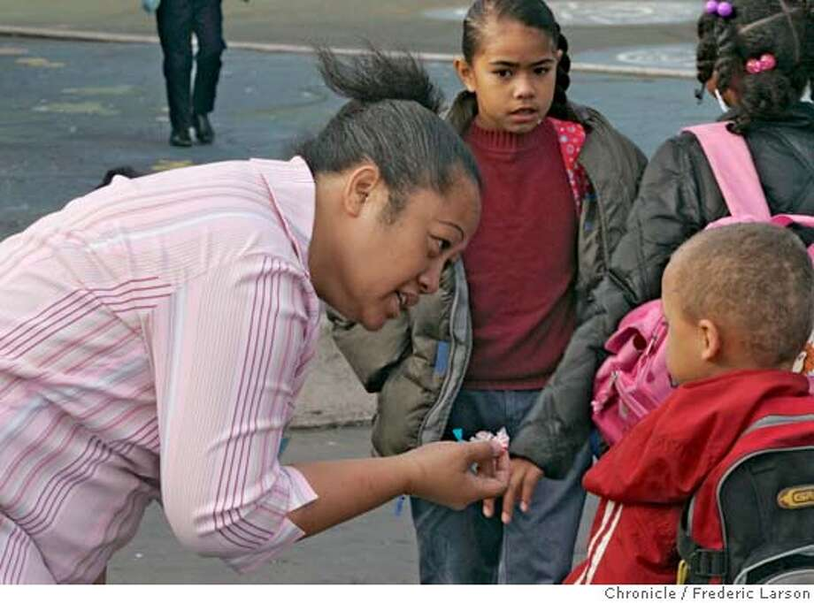 MALCOLMX_O128_fl.jpg Starr Miles, a parent and employee of the MalcolmX elementary school in the Hunters Point district of San Francisco tells a student the importance of a good breakfast over pieces of candy. 11/2/05 San Francisco CA Frederic Larson San Francisco Chronicle Photo: Frederic Larson