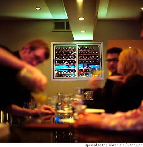 TOP 100 RANGE 04.jpg  A bartender works on drinks at the bar in the front dining room at Range in San Francisco's Mission District.  By JOHN LEE/SPECIAL TO THE CHRONICLE Photo: JOHN LEE