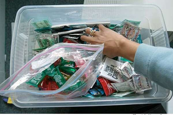 CCPP21C-C-03MAR03-CF-LI  Tedra Tanner Sr Health Educator from Planned parenthood who offers clinical services at three Contra Costa high schools reaches into a tub of condoms that she hands out to Students at John Swett High School in Crockett. By LANCE IVERSEN/SAN FRANCISCO CHRONICLE-NOTE PHOTO IS NOT COLOR CORRECTED ) NORTHERN CA MANDATORY CREDIT PHOTOG & SF CHRONICLE/ -MAGS OUT; CAT