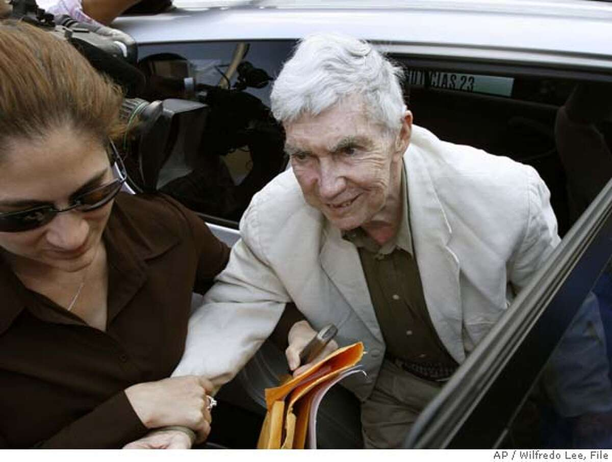** FILE ** Anti-Castro Cuban militant Luis Posada Carriles, center, is helped out of the car by his daughter, Janet Arguello, as he arrives at his wife's house in Miami in this April 19, 2007 file photo after being released from federal custody. A federal judge on Tuesday, May 8, 2007 threw out an indictment accusing a Cuban militant of lying to immigration authorities, saying the government manipulated Luis Posada Carriles' naturalization interview. (AP Photo/Wilfredo Lee, File) APRIL 19, 2007 FILE PHOTO
