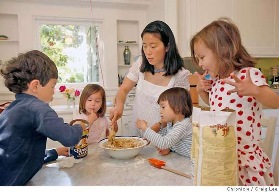 "MOMS09_386_cl.JPG  Story for Food mother's day story. Photo of Joohee Muromcew, author of ""The Baby Bistro Cookbook,"" with her children, making Oatmeal Cranberry Cookies. Left-right: Alexei (age 6), Natasha, Joohee, Mary, and Nikita. The three little girls are 3 years-old triplets.  Event on 4/30/07 in Ross. photo by Craig Lee / The Chronicle MANDATORY CREDIT FOR PHOTOG AND SF CHRONICLE/NO SALES-MAGS OUT Photo: Photo By Craig Lee"
