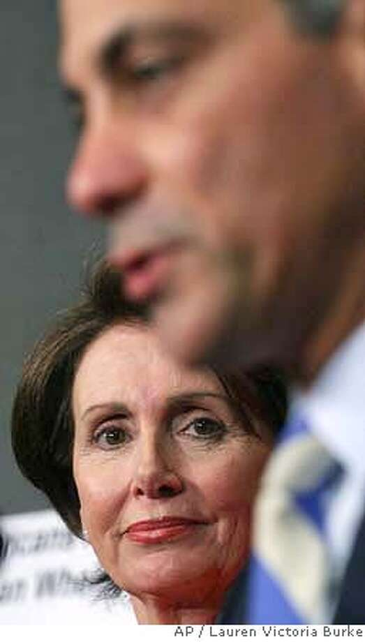 House Speaker Nancy Pelosi of Calif., left, listens as Rep. Rahm Emanuel, D-Ill., talk on rising gasoline prices and Iraq during a news conference on Capitol Hill in Washington, Tuesday, May 8, 2007. (AP Photo/Lauren Victoria Burke) Photo: LAUREN VICTORIA BURKE