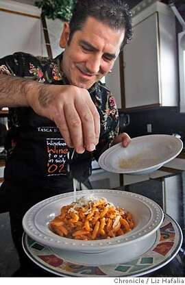 CHEF25_089_LH_.JPG La Ciccia owner and chef Massimiliano Conti putting grated pecorino cheese on his pasta dish after preparing it at his San Francisco home. Liz Hafalia/The Chronicle/San Francisco/4/10/07  **Massimiliano Conti cq �2007, San Francisco Chronicle/ Liz Hafalia  MANDATORY CREDIT FOR PHOTOG AND SAN FRANCISCO CHRONICLE. NO SALES- MAGS OUT.