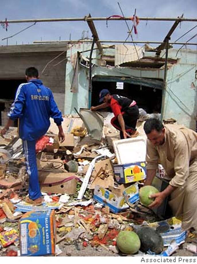 Residents search through the rubble of a shop following a car bomb blast in Ramadi, 115 kilometers (70 miles) west of Baghdad, Iraq, Monday, May 7, 2007. Two suicide car bombers attacked a market and a police checkpoint on the outskirts of Ramadi, killing at least 20 people and dealing a blow to recent U.S. success in reclaiming the Sunni city from insurgents. (AP Photo) Photo: X