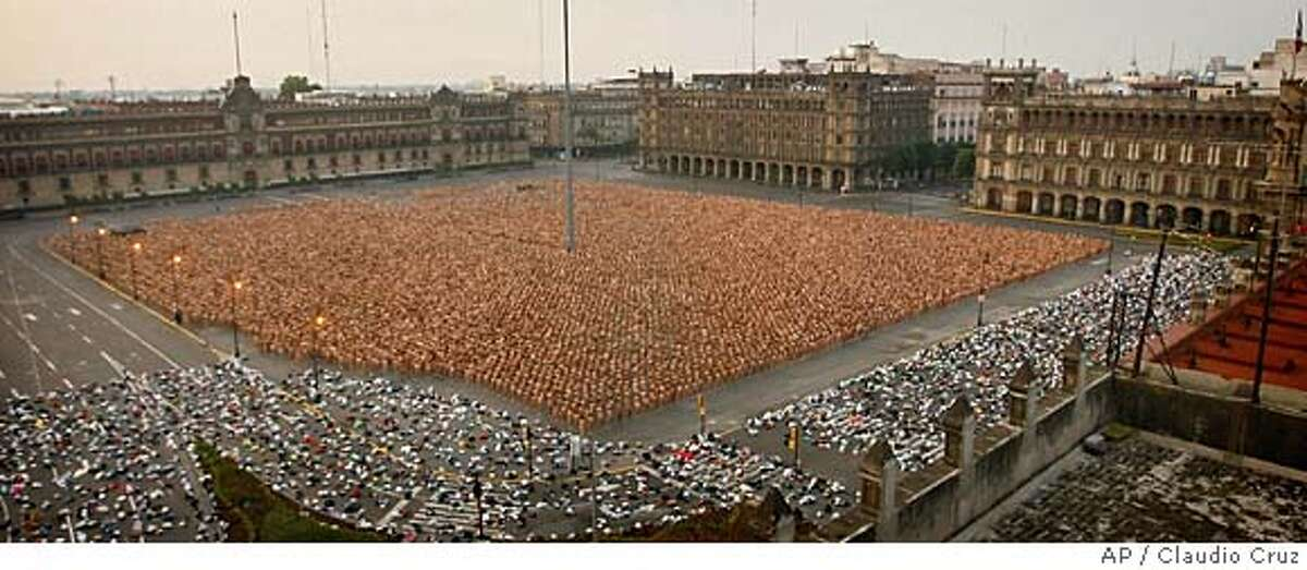 Thousands of naked people fill Mexico City's main Zocalo plaza during the massive naked photo session with U.S. photographer Spencer Tunick in the early hours of Sunday May 6, 2007. According to the organizers, almost 20 thousand people took off their clothes.(AP Photo/Claudio Cruz)