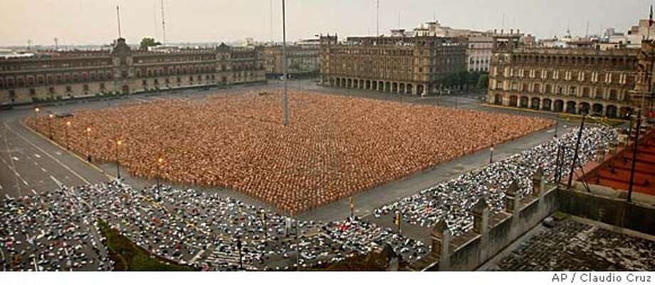 Thousands of naked people fill Mexico City's main Zocalo plaza during the massive naked photo session with U.S. photographer Spencer Tunick in the early hours of Sunday May 6, 2007. According to the organizers, almost 20 thousand people took off their clothes.(AP Photo/Claudio Cruz) Photo: Claudio Cruz