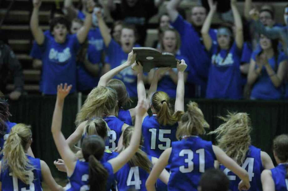 Hoosic Valley High School girls carry their state championship plaque across the basketball court to their cheering fans after their win during the Class C girls' basketball final between Hoosic Valley High School and Randolph Central School on Sunday, March 18, 2012 at the McDonough Sports Complex at Hudson Valley Community College in Troy, NY.  (Paul Buckowski / Times Union) Photo: Paul Buckowski