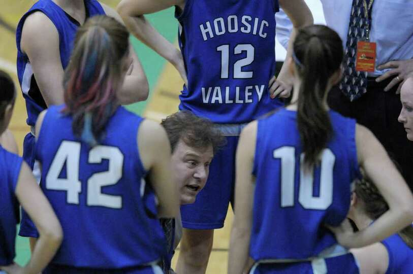 Head coach, Walter Dorman, of Hoosic Valley High School talks to his team during a timeout  during t