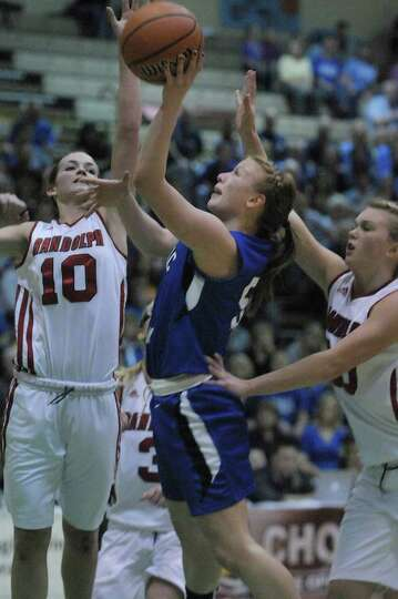 Alicia Lewis, center, of Hoosic Valley High School puts up a shot during the Class C girls' basketba