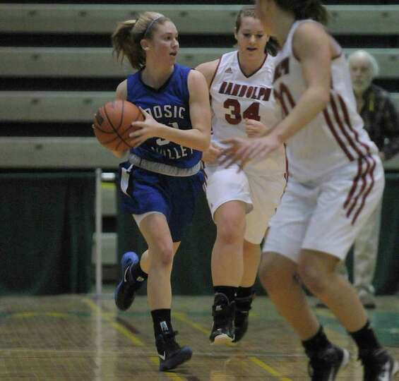 Kim Kocienski, left, of Hoosic Valley High School looks to pass to a teammate during the Class C gir