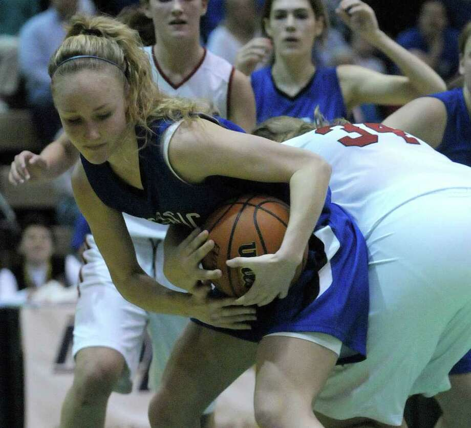 Rachel Moore, left, of Hoosic Valley High School fights for a rebound during the Class C girls' basketball final between Hoosic Valley High School and Randolph Central School on Sunday, March 18, 2012 at the McDonough Sports Complex at Hudson Valley Community College in Troy, NY.  (Paul Buckowski / Times Union) Photo: Paul Buckowski