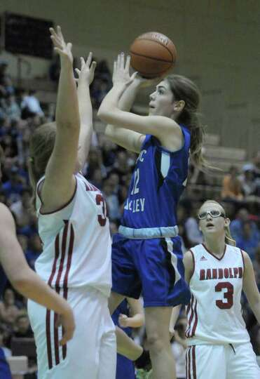 Morgan Anderson, right, of Hoosic Valley High School put up a shot during the Class C girls' basketb