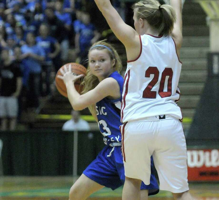 Samantha Connors, right, of Hoosic Valley High School looks to pass to a teammate during the Class C girls' basketball final between Hoosic Valley High School and Randolph Central School on Sunday, March 18, 2012 at the McDonough Sports Complex at Hudson Valley Community College in Troy, NY.  (Paul Buckowski / Times Union) Photo: Paul Buckowski