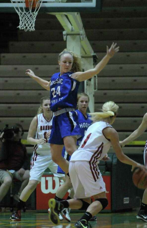 Rachel Moore, left,  of Hoosic Valley High School tries to block a shot during the Class C girls' basketball final between Hoosic Valley High School and Randolph Central School on Sunday, March 18, 2012 at the McDonough Sports Complex at Hudson Valley Community College in Troy, NY.  (Paul Buckowski / Times Union) Photo: Paul Buckowski