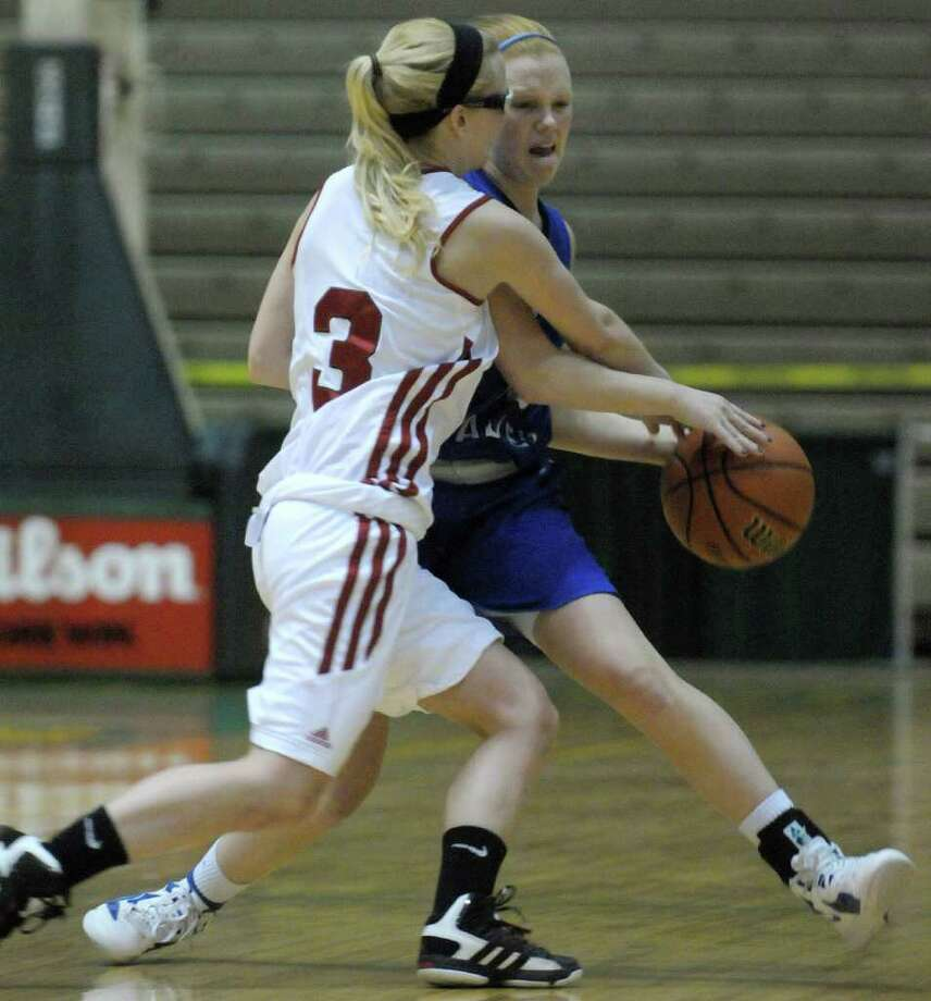 Cheyanne France, left, of Randolph Central School, fouls Whitney Kugler of Hoosic Valley High School as she tried to steal the ball during the Class C girls' basketball final between Hoosic Valley High School and Randolph Central School on Sunday, March 18, 2012 at the McDonough Sports Complex at Hudson Valley Community College in Troy, NY.  (Paul Buckowski / Times Union) Photo: Paul Buckowski