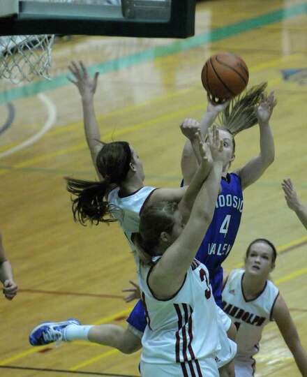 Cassidy Chapko, right, of Hoosic Valley High School drives the lane and puts up a shot during the Cl