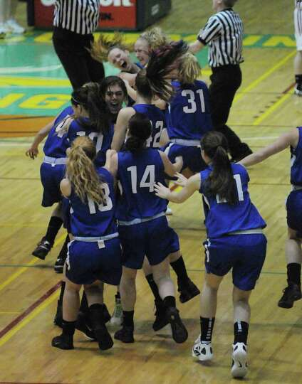 Hoosic Valley High School girls celebrate their win during the Class C girls' basketball final betwe