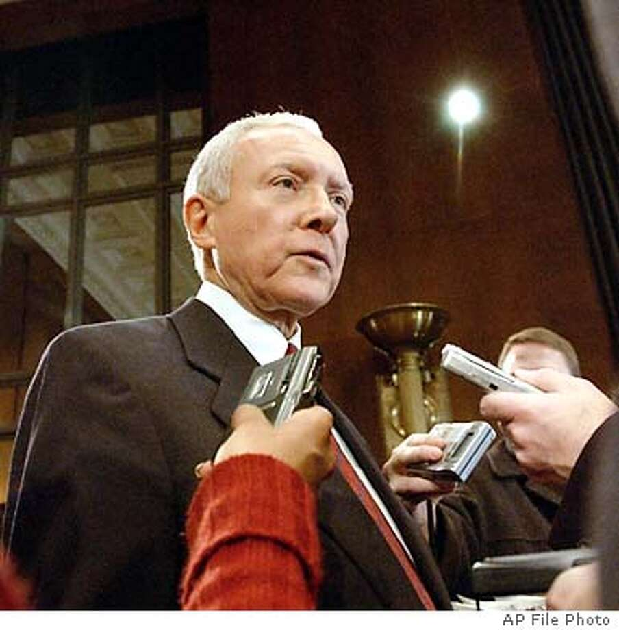 ** FILE ** Senate Judiciary Committee Chairman Sen. Orrin Hatch, R-Utah, is shown in this Jan. 30, 2003 file photo, taken in Washington. Hatch sent a letter Friday, July 18, 2003, to Sens. Carl Levin and Debbie Stabenow saying he will schedule hearings for six Michigan judges despite the protests of Michigan's Democratic senators. All of the judges were nominated by President Bush. Levin and Stabenow had no immediate comment Monday. (AP Photo/Evan Vucci, File) Photo: EVAN VUCCI