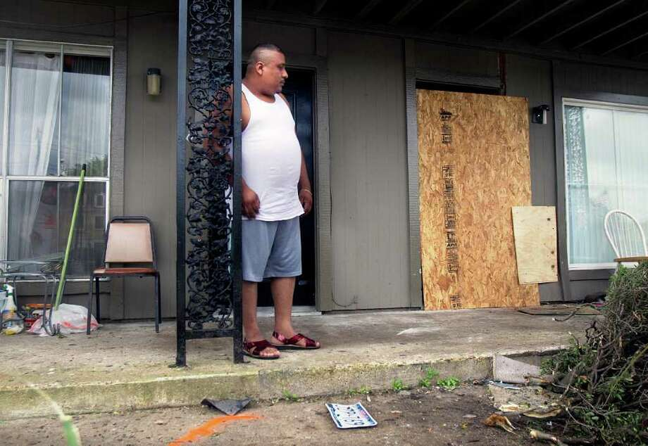 "Neighbor Ignacio Villalba stands on his front porch where a suspected drunken driver's car crashed on Saturday night, striking two of his neighbors' children. ""It all happened so fast,"" Villalba said. Photo: Cody Duty / © 2011 Houston Chronicle"