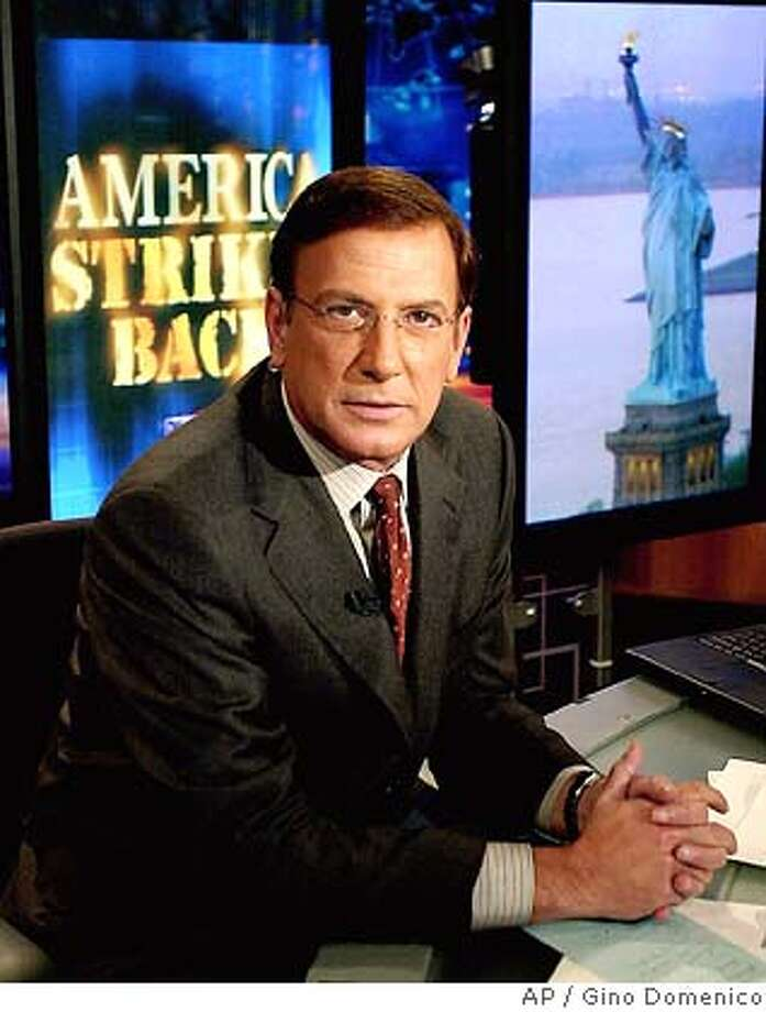 **FILE**CNN news anchor Aaron Brown poses in one of the all-news network's New York studios Oct. 18, 2001. Brown, once one of CNN's most prominent anchors, is leaving the network after a shakeup that gives his prime-time slot to rising star Anderson Cooper and expands it to two hours.(AP Photo/Gino Domenico) AN OCT 18 2001 FILE PHOTO Photo: GINO DOMENICO
