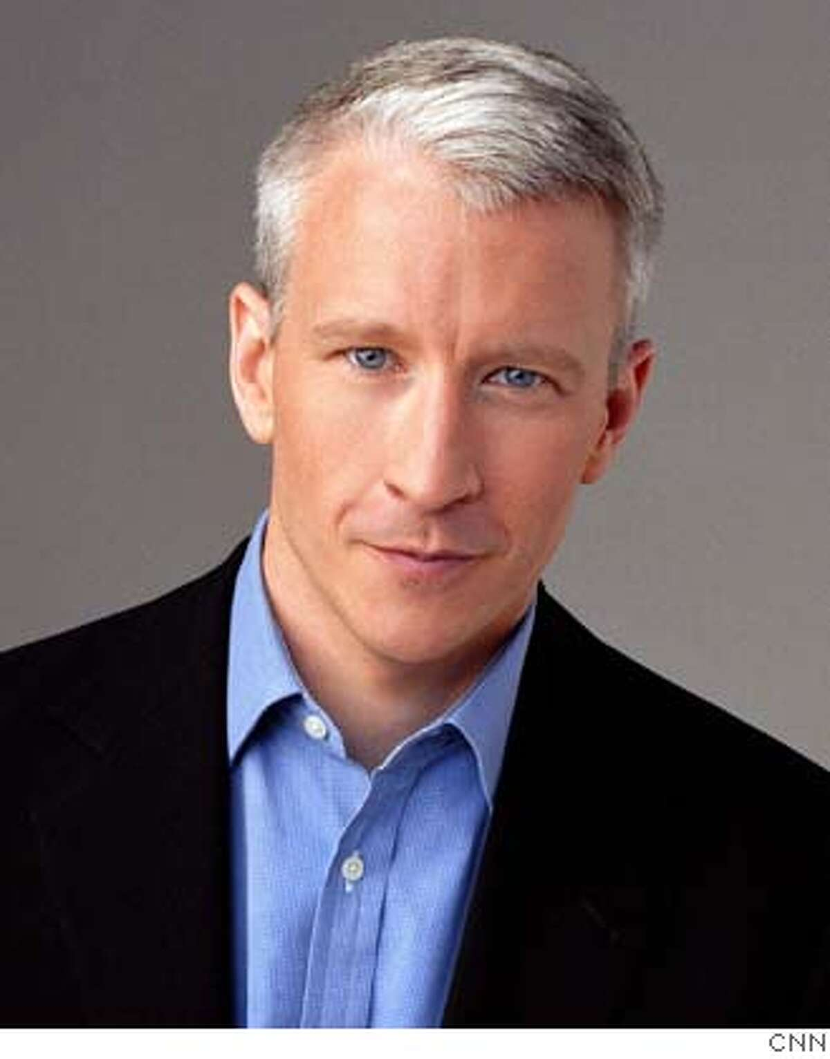 """CNN news anchor Anderson Cooper, shown in this undated publicity photograph, will take the helm of a live news program from 10 p.m. to midnight (EST) (1700 GMT to 1900 GMT), on CNN beginning November 7, 2005. Cooper, who has reported from the scene of major news events such as Hurricane Katrina, the famine in Niger, the Terry Schiavo case and the war in Iraq, will continue his program """"Anderson Cooper 360�"""" in its new time slot. NO ARCHIVES REUTERS/CNN/Handout 0"""