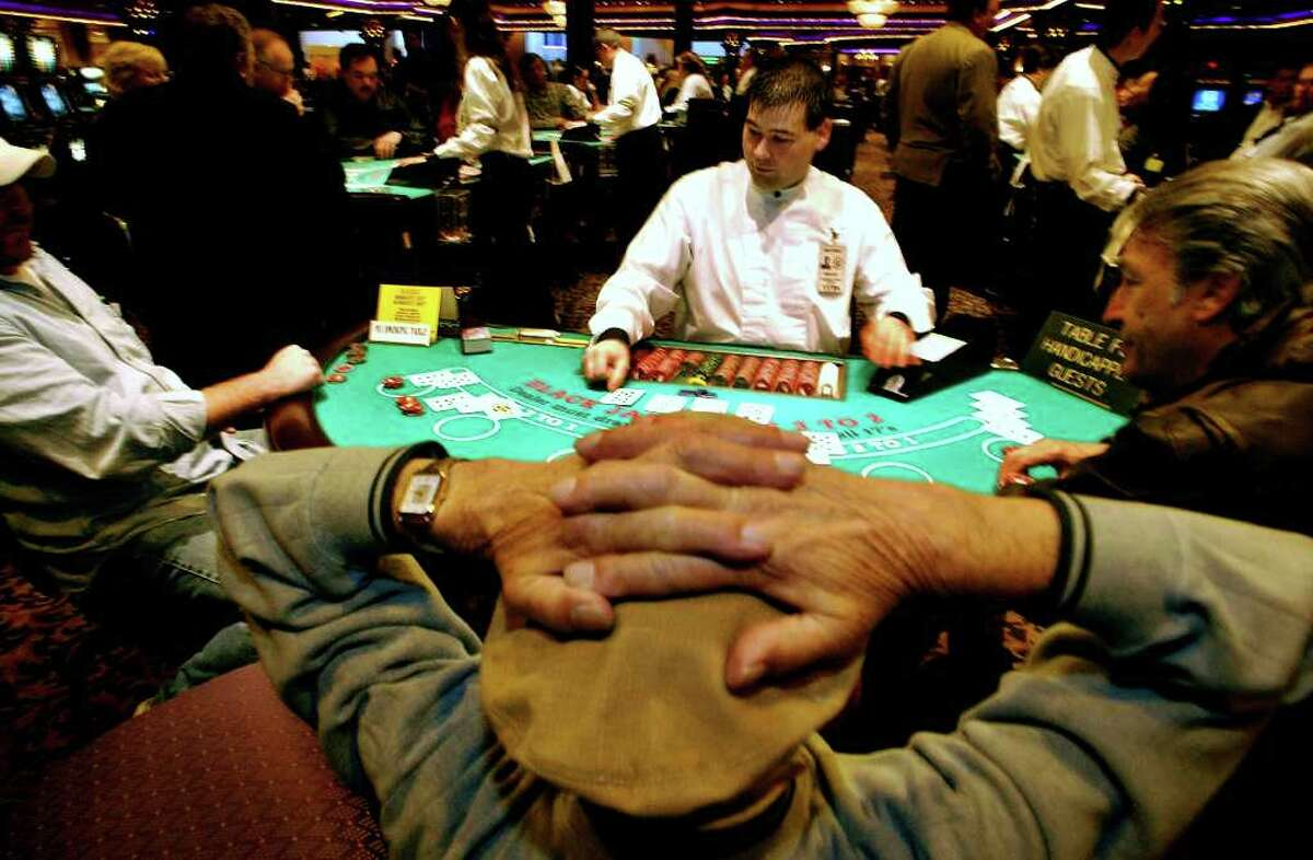 Dealer Matthew Muckey deals black jack at Turning Stone Casino in Verona , N.Y Thursday December 19, 2002. (Michael P. Farrell / Times Union Archive)