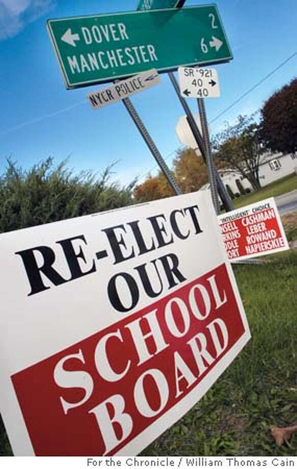 Dover, PA - NOVEMBER 4: Campaign signs for and against the current Dover School District school board litter the town November 4, 2005 in Dover, Pennsylvania. (Photo by William Thomas Cain/) Photo: William Thomas Cain