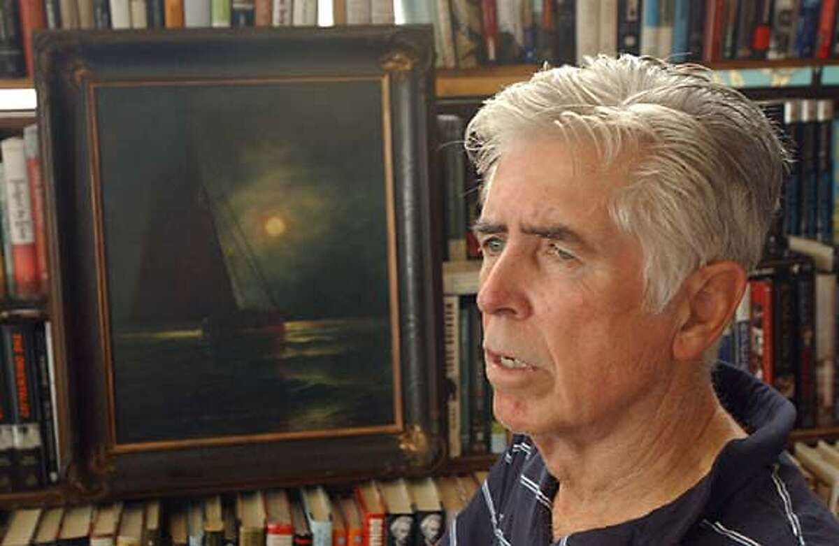 Davis Dutton pose for photographs next to Jessey Dorr's painting