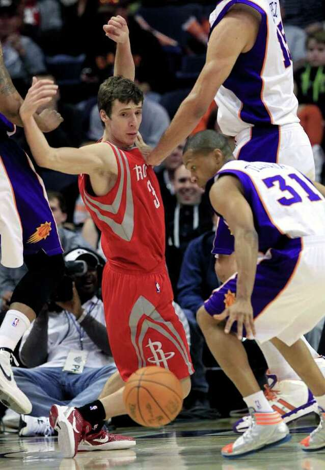 Houston Rockets' Goran Dragic (3), of Slovenia, gets the balled stripped by Phoenix Suns' Sebastian Telfair (31) during the second quarter of an NBA basketball game, Sunday, March 18, 2012, in Phoenix. (AP Photo/Ross D. Franklin) Photo: Ross D. Franklin, Associated Press / AP