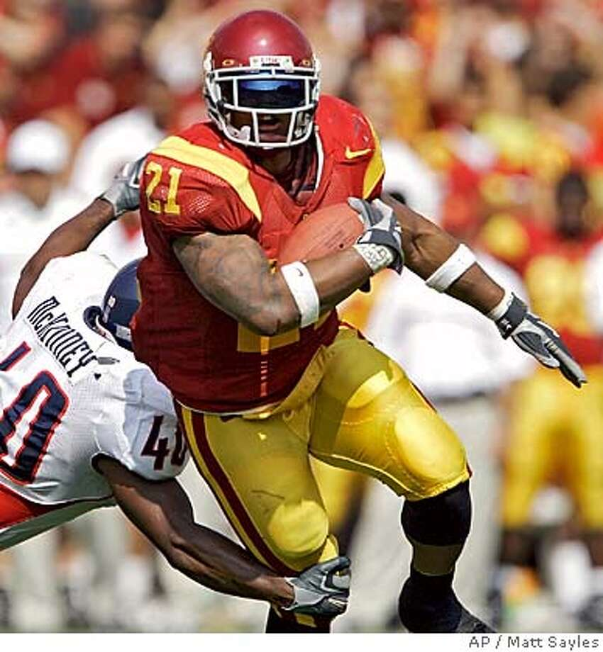 Southern California's LenDale White breaks a tackle by Arizona's John McKinney during the fourth quarter of their game Saturday, Oct. 8, 2005, in Los Angeles. (AP Photo/Matt Sayles) Photo: MATT SAYLES