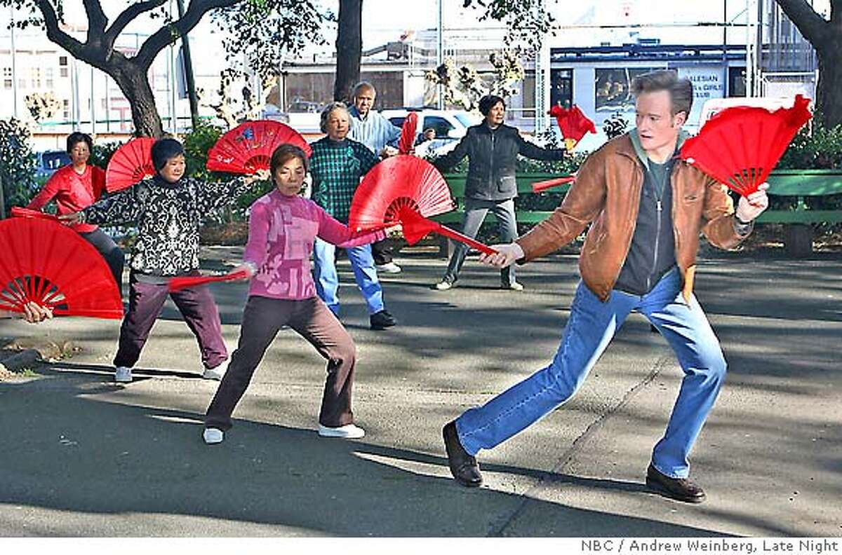 """Conan starts his tour of San Francisco with a visit to Washington Square Park where he tries his hand at some tai chi. Photo credit: Andrew Weinberg/""""Late Night"""""""