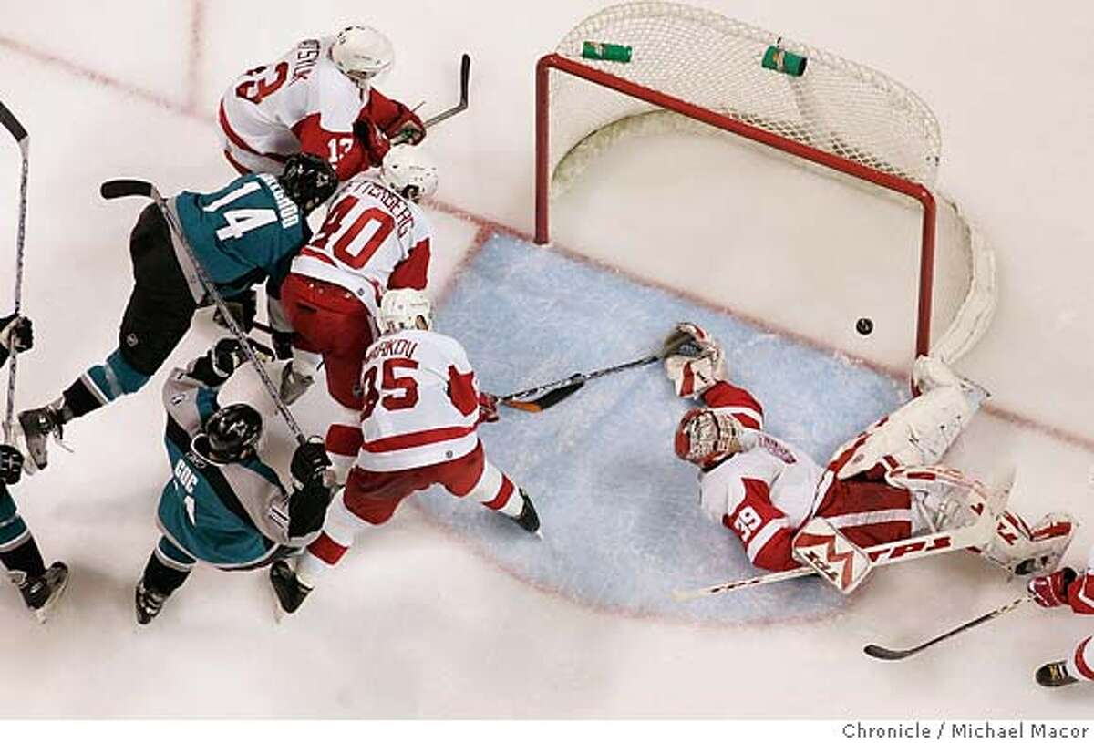 sharks3_0929_mac.jpg Sharks 14- Jonathan Cheechoo slips the puck past Detroit's goalie Dominik Hasek for tthe game winning goal in the 3rd period. The San Jose Sharks vs. The Detroit Red Wings, Game 3 of the Western conference semi-finals, Stanley Cup semi-finals,seriestied at 1-1. Photographed in, Detroit, Ca, on 4/30/07. Photo by: Michael Macor/ The Chronicle