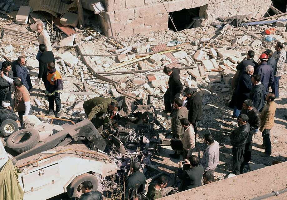 """A handout picture released by the official Syrian Arab News Agency (SANA) shows Syrian investigators inspecting a car at the blast scene outside a damaged building following a car bomb in Syria's second largest city of Aleppo leaving dead and wounded on March 18, 2012, a day after two lethal blasts in the capital. The Syrian Observatory for Human Rights, in a statement, said the latest blast targeted political security offices in the northern city of Aleppo, leaving dead and wounded. AFP PHOTO/HO/SANA -- RESTRICTED TO EDITORIAL USE - MANDATORY CREDIT """"AFP PHOTO / HO / SANA"""" - NO MARKETING NO ADVERTISING CAMPAIGNS - DISTRIBUTED AS A SERVICE TO CLIENTS --  AFP IS USING PICTURES FROM ALTERNATIVE SOURCES AS IT WAS NOT AUTHORISED TO COVER THIS EVENT, THEREFORE IT IS NOT RESPONSIBLE FOR ANY DIGITAL ALTERATIONS TO THE PICTURE'S EDITORIAL CONTENT, DATE AND LOCATION WHICH CANNOT BE INDEPENDENTLY VERIFIED (Photo credit should read -/AFP/Getty Images) Photo: -, AFP/Getty Images"""