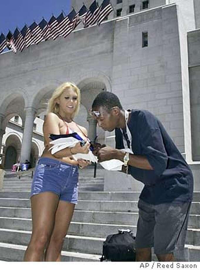 8/6/2003 | B/W | 5star | 16p9 x 3.5i | a12 | A-Section | rcs-7961 | porn star Photo: REED SAXON