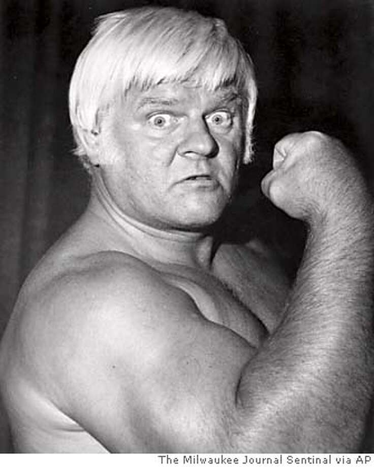 "Reggie (""Da Crusher"") Lisowski, shown in this 1986 photo, has died of a brain tumor on Saturday, Oct. 22, 2005. He was 79. An icon in professional wrestling circles, he was considered a man of the people because of his blue-collar Milwaukee roots.(AP Photo/The Milwaukee Journal Sentinal) 1986 PHOTO Photo: Mjs"